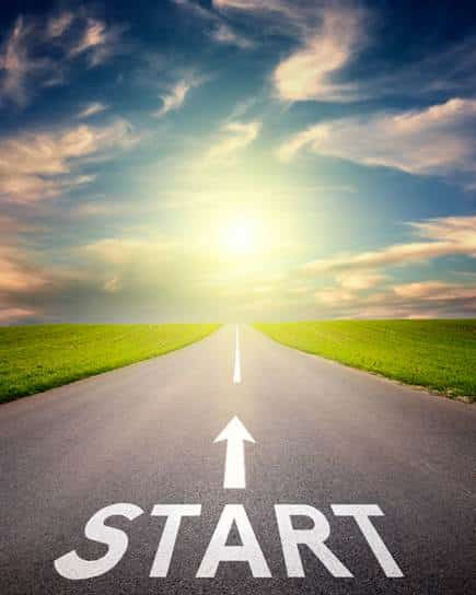 Start written on road leading toward sunrise or sunset
