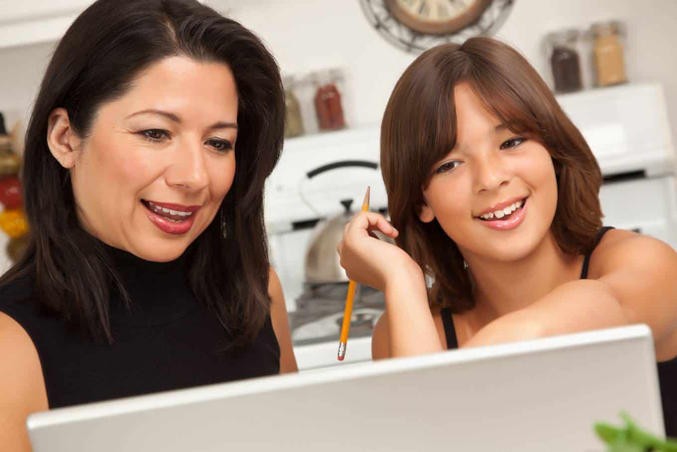 Mom and daughter looking at computer together