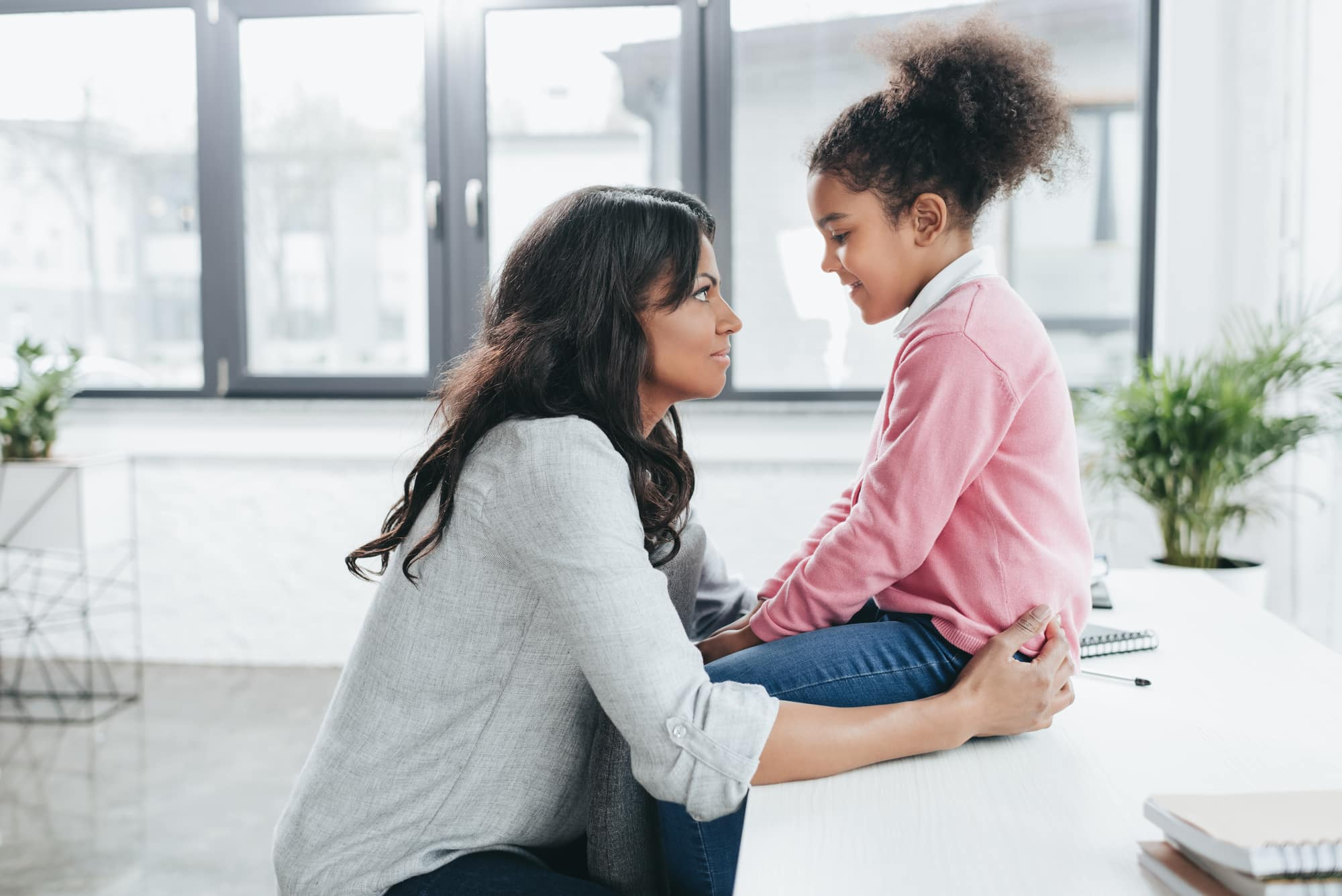 Mother talking to her daughter