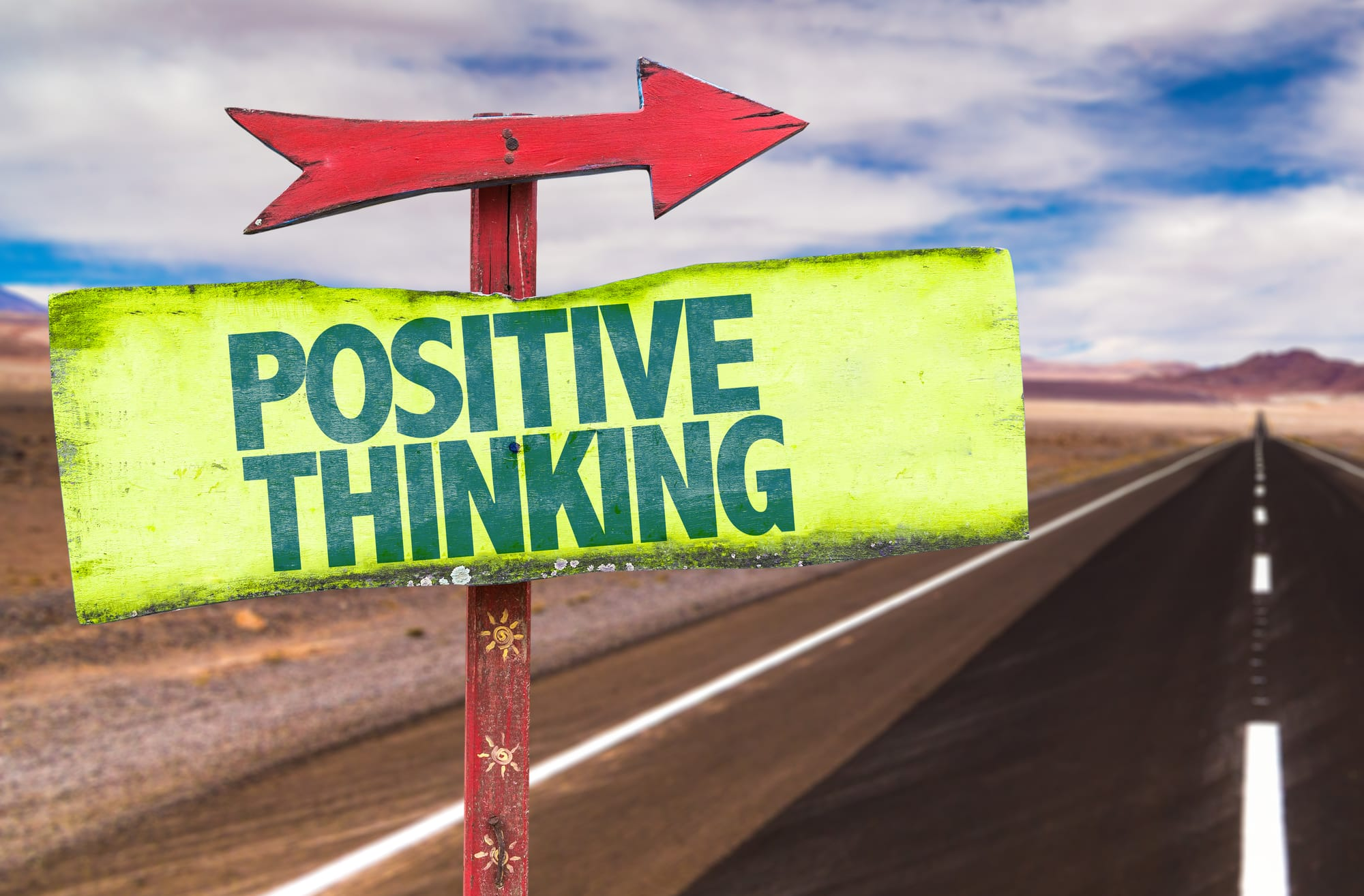 Arrow and sign saying positive thinking