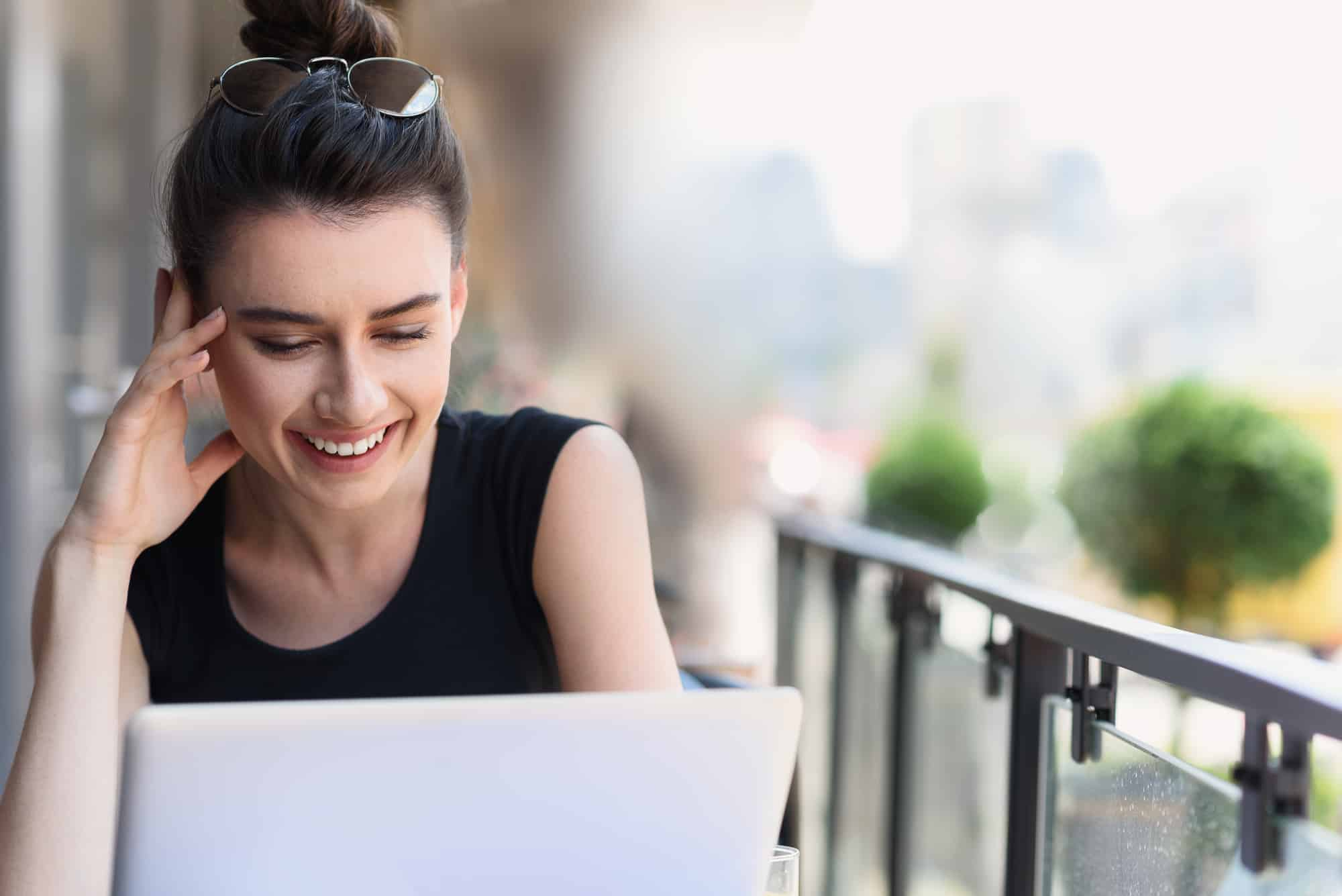 Woman smiling and looking at computer screen